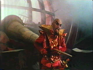 Ming the Merciless impaled on the spike of Flash Gordon's spaceship