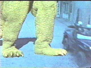 Bright green monster legs betray tiny budget.